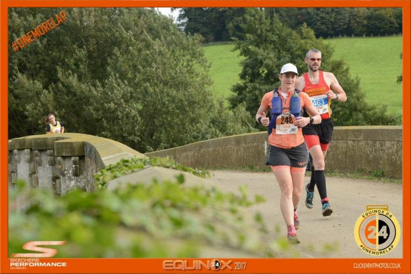Image of Kat running over a bridge at Equinox24